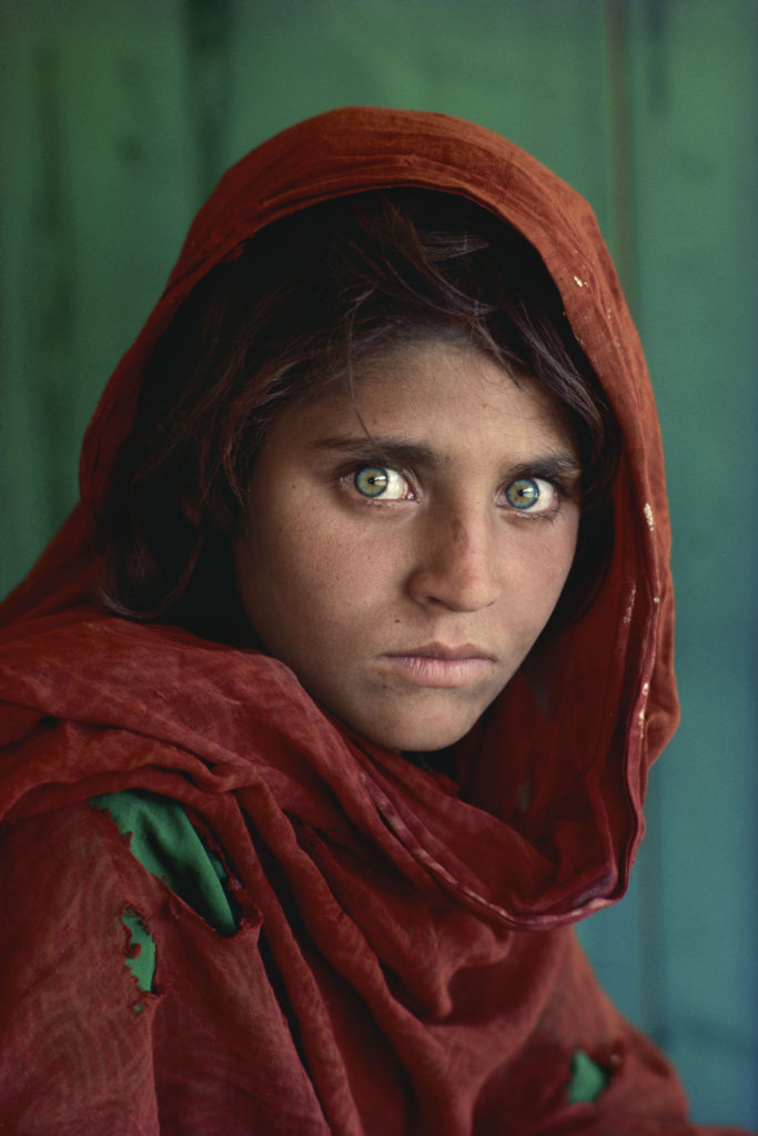 Sharbat Gula, 13, by Steve McCurry. Pakistan, Peshawar, 1984. Afghan Girl at Nasir Bagh refugee  ...