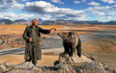 Old man with a bear, Mongolia. Picture Hamid Sardar