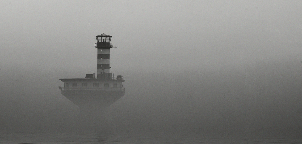 Lighthouse in the mist, Quebec, Canada