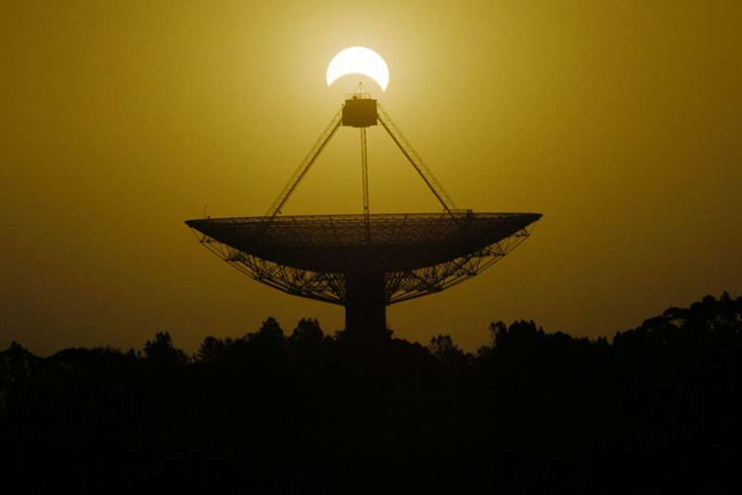 Parkes observatory radio telescope antenna, Australia, during a solar eclipse