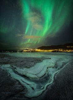 Night sky over frozen shores of Trondheim's fjord, Norway