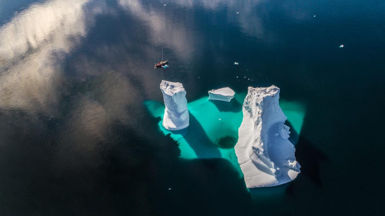 Small boat and big iceberg