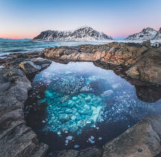 Crystal sea water pool, Skagsanden beach, Lofoten, Norway | OutdoorMountain