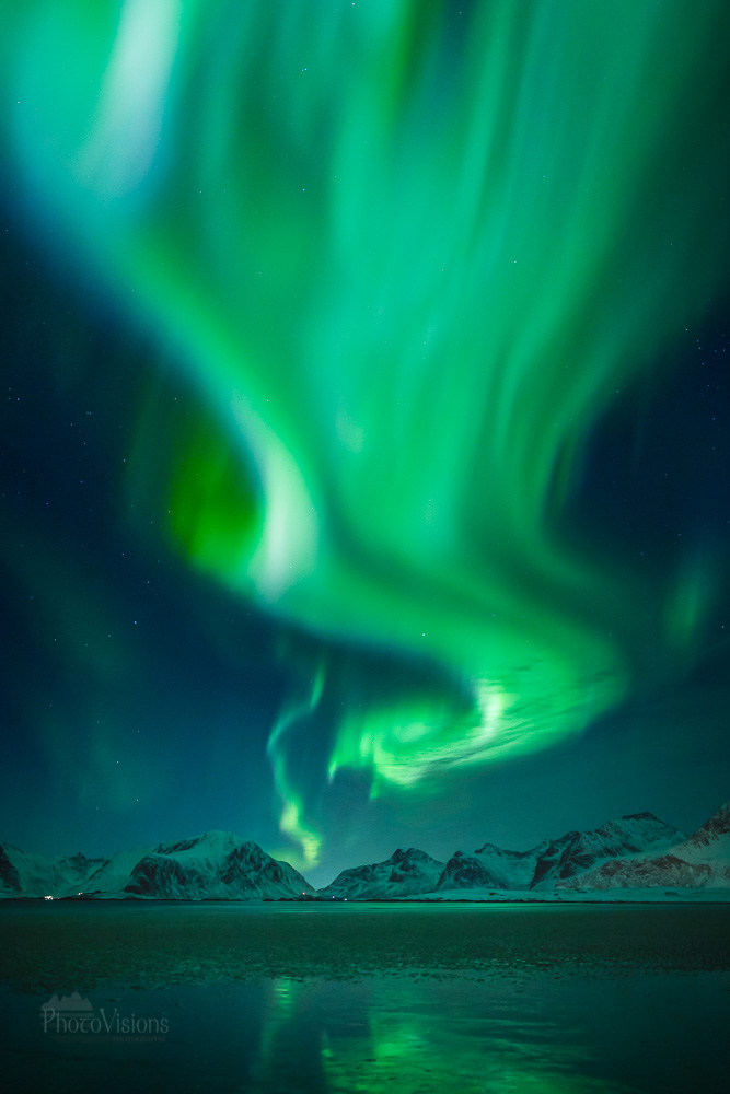 Green twister above the Lofoten Islands, Norway | OutdoorMountain